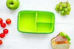 Healthy break with apple, grape and sandwich in lunchbox on home Royalty Free Stock Photo
