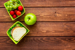 Healthy break with apple, grape and sandwich in lunchbox on home table flat lay mock-up. Healthy break with apple, grape and sandwich in green lunchbox on home stock photography