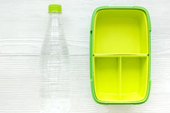 Healthy break with bottle of water and lunchbox on home table flat lay mock-up Royalty Free Stock Images