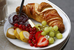 Healthy breakfast. A healthy breakfast with fresh fruit and a croissant Royalty Free Stock Images