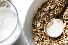 Healthy breakfast. Flakes and milk glass and spoon Stock Photography
