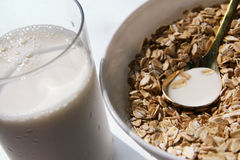 Healthy breakfast. Flakes and milk glass and spoon Stock Photos
