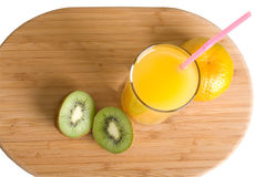 Healthy breakfast. Fruit and juice glass on a board the top view Royalty Free Stock Photos