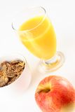 Healthy breakfast. Orange juice with cereals and red apple Royalty Free Stock Photo