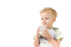 Healthy breakfast. The boy is supported with the cow milk Royalty Free Stock Photo
