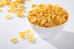 Healthy breakfast. Milk with corn flakes on white royalty free stock image