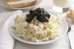 Healthy breakfast. Curds with prunes and walnuts for breakfast Stock Photos