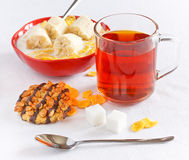 Healthy breakfast. Cornflakes with banana in bowl and tea with cookie Royalty Free Stock Photo