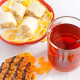 Healthy Breakfast. Cornflakes with banana in bowl and tea with cookie Royalty Free Stock Images