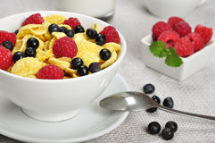 Healthy breakfast. Corn flakes, raspberry and  blueberry in white bowl close up Royalty Free Stock Image