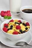 Healthy breakfast. Corn flakes, raspberry and  blueberry in white bowl close up Stock Photo