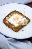 Healthy breakfast. Egg baked in whole almond-carrot bread royalty free stock image