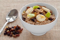 Healthy Breakfast. A Bowl of Bran Flakes with Raisins, Sultanas, Banana and Apple Pieces royalty free stock images