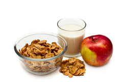 Healthy Breakfast. Apple, cereal and yogurt in a glass on a white background Stock Image