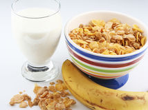 Healthy breakfast. Including cereal bowl, milk glass, and banana stock image