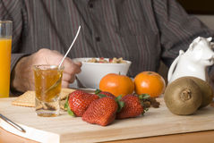 Healthy breakfast. With fruit, milk, cereals, biscuits, marmalade Stock Images