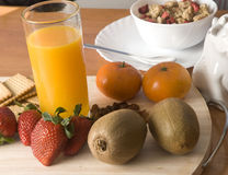 Healthy breakfast. With fruit, milk, cereals, biscuits, marmalade Stock Photo