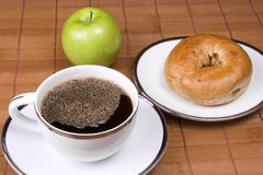 Healthy Breakfast. Coffee bagel and apple on a brown background Stock Photo