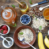 A healthy breakfast with an abundance of fresh fruits, flakes and green tea. Morning Stock Photos