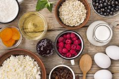 Healthy breakfast. Authentic elements for cooking homemade granola. Summer time. Seasonal food. Royalty Free Stock Image
