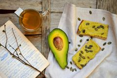 Healthy breakfast with avocado and chickpea pesto with tea Stock Photography
