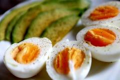 Healthy breakfast - avocado and eggs stock photos