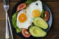 Healthy breakfast. Avocado, eggs sandwich with whole grain bread on wooden background. Copy space. Avocado egg sandwich with whole grain bread on wooden stock photo