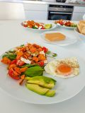 Healthy breakfast with avocado and fried eggs stock photos