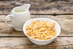 Healthy breakfast background. Bowl of corn flakes with jar of milk Royalty Free Stock Photo