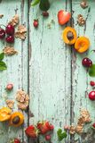 Healthy Breakfast Background with Cereal, Cherry, Strawberry and Apricot. On blue background royalty free stock photos