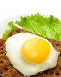 Healthy breakfast background: fried eggs, lettuce, crisp bread Stock Photo