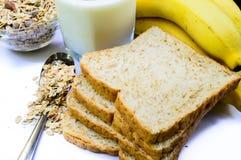 A healthy breakfast. Breakfast with bananas, bread, milk and muesli Stock Photos