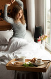 Healthy breakfast in bed with coffee royalty free stock photography