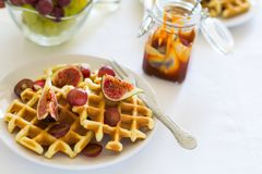 Healthy breakfast: Belgian waffles with figs, grapes and caramel Stock Photography