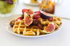 Healthy breakfast: Belgian waffles with figs, grapes and caramel Stock Photo