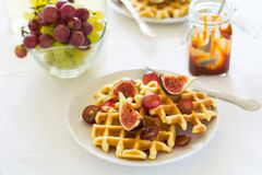 Healthy breakfast: Belgian waffles with figs, grapes and caramel Royalty Free Stock Photo