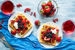 Healthy breakfast: Belgian waffles with sour cream, strawberry, raspberry, blueberry, cherry and red currant Royalty Free Stock Images