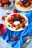 Healthy breakfast: Belgian waffles with sour cream, strawberry, raspberry, blueberry, cherry and red currant Stock Photos