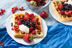Healthy breakfast: Belgian waffles with sour cream, strawberry, raspberry, blueberry, cherry and red currant Royalty Free Stock Photo