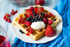 Healthy breakfast: Belgian waffles with sour cream, strawberry, raspberry, blueberry, cherry and red currant Royalty Free Stock Image
