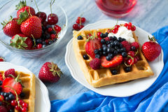 Healthy breakfast: Belgian waffles with sour cream, strawberry, raspberry, blueberry, cherry and red currant Royalty Free Stock Photography
