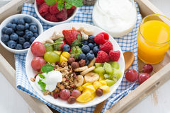 Healthy breakfast - berries, fresh fruit and cereal, top view Stock Photography