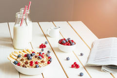 Healthy breakfast with berries and milk on the white wooden table royalty free stock photos