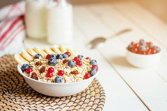 Healthy breakfast with berries and milk on the white wooden table stock photography