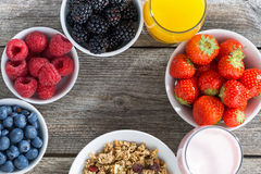 Healthy breakfast with berries on wooden background, close-up Royalty Free Stock Photography
