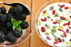 Healthy breakfast with blackberries goji berries Royalty Free Stock Photo
