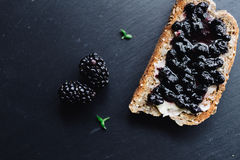 Healthy breakfast with blackberry jam. With toast on black slate background Stock Photography