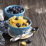Healthy breakfast. Blue portioned ceramic bowls with corn flakes  fresh blueberries Royalty Free Stock Image