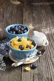 Healthy breakfast. Blue portioned ceramic bowls with corn flakes  fresh blueberries Royalty Free Stock Photo