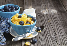 Healthy breakfast. Blue portioned ceramic bowls with corn flakes  fresh blueberries Stock Images